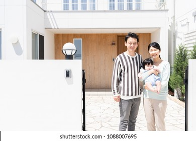 portrait of asain family on entrance of house