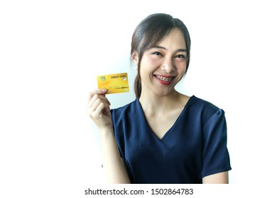 Portrait Asia smiling woman with credit card in hand,happy to have money concept.