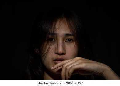 Portrait of asia woman  in darkness with soft light