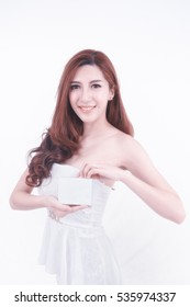 portrait of asia woman  showing blank box posing on white background, beauty skincare concept