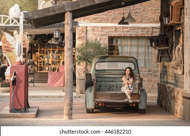 Portrait of a asia woman at vintage gas station.