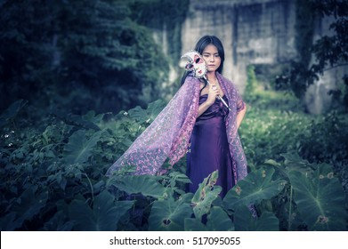 portrait of asia women with mask on nature, canival concept