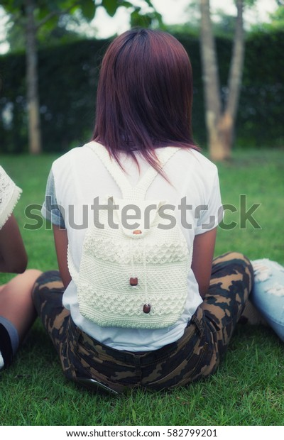 portrait of asia young girl with bag on park, on outdoor