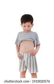 Portrait of Asian baby boy age about 3 years old lifting his shirt show exposing his big tummy isolated on white background.