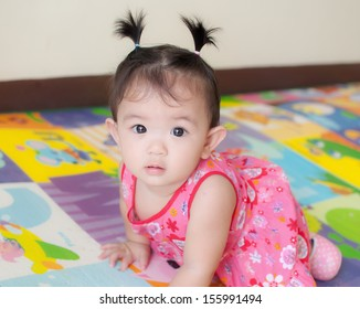 portrait of asian baby girl, looking at camera