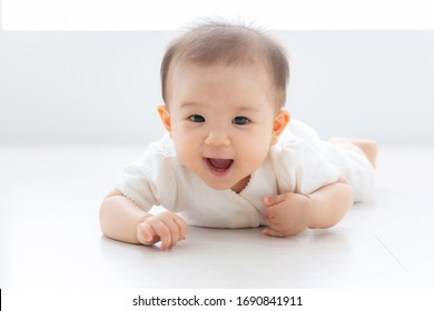 portrait of asian baby lying