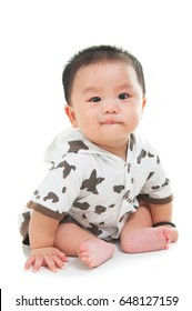 Portrait of asian baby sitting on the floor