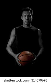 Portrait of Asian Basketball Player On Black Background