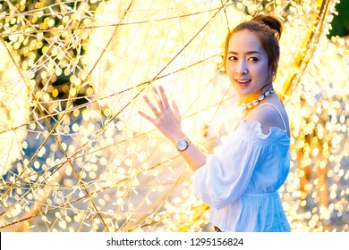 portrait asian beautiful women of smiling with blur bokeh light background and fashion shirt white or jeans