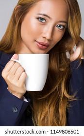 Portrait of an asian beauty having coffee.