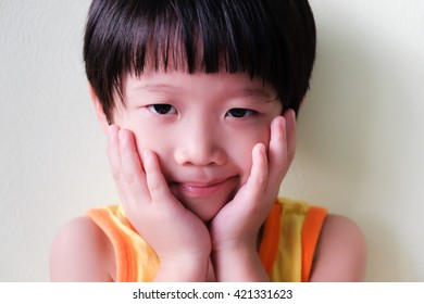 Portrait of asian boy on white background with copyspace