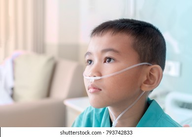 A portrait of asian boy sick heavy patient. Doctor give an oxygen when he Asthma. A asian child in Patients green dress.