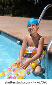 portrait of asian boy with swimming gear