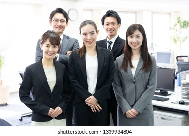 portrait of asian business group in office