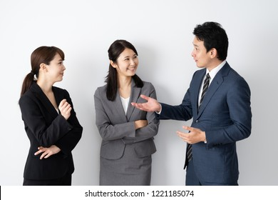 portrait of asian business group talking on white background