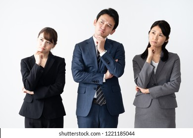 portrait of asian business group thinking on white background