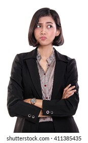 Portrait of an Asian business woman looking at her side with suspicious eyes, isolated on white background