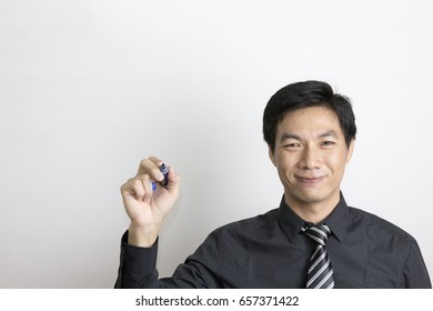 Portrait of Asian Businessman Drawing Something on Transparent Screen.
