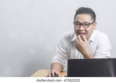 Portrait Asian Businessman happy In front of the computer copy space for text.