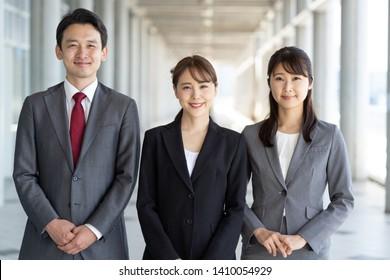 portrait of asian businessteam standing in passageway