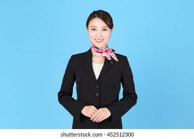 portrait of asian businesswoman isolated on blue background