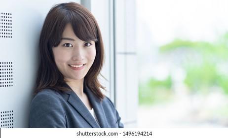 portrait of asian businesswoman relaxing