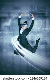 Portrait of Asian businesswoman wearing a virtual reality glasses while doing ballet dances