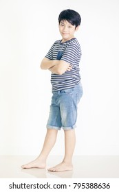 Portrait of asian cute boy with smile face, Shooting in studio on white background.