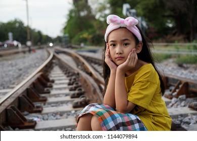 Portrait Asian cute little girl Railway background