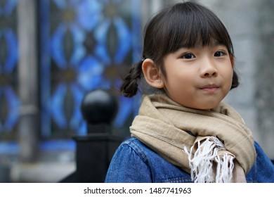 Portrait Asian cute little girl smiling happy