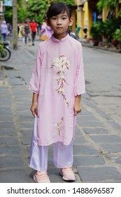 Portrait Asian cute little girl smiling happy Wear Vietnam national costume Ao dai