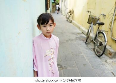 Portrait Asian cute little girl Wear Vietnam national costume Ao dai