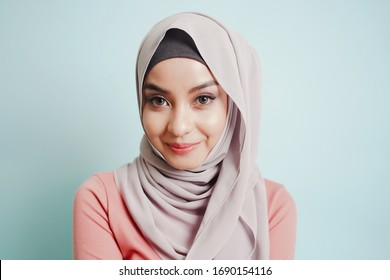 Portrait of Asian cute smile Muslim teenage girl wearing islamic dress hijab is looking to camera.
