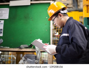 Portrait of asian engineer checking technical data in the factory