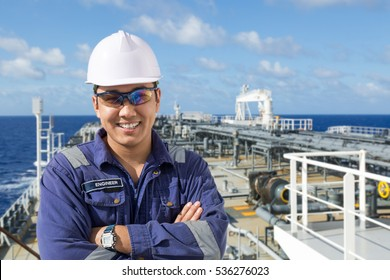 Portrait asian engineer on the ships deck.