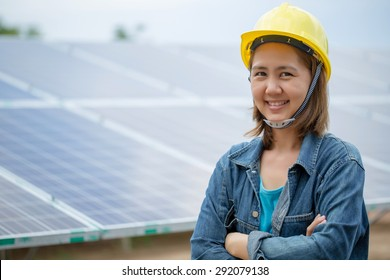 Portrait Asian engineer woman front of  solar panel