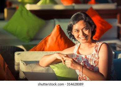 Portrait of Asian Ethnic Adult Female Feeling Happy and Smiling