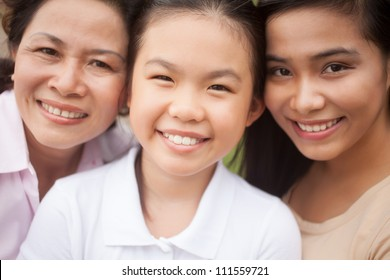Portrait of Asian family looking at camera