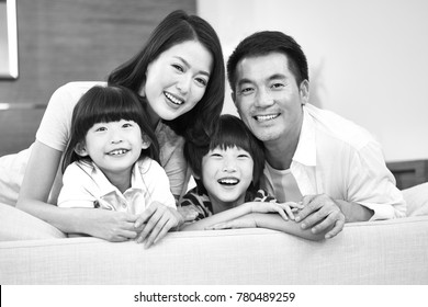 portrait of an asian family with two children, happy and smiling, black and white.
