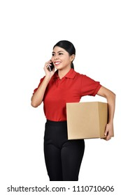 Portrait of asian female courier with cell phone carrying boxes standing isolated over white background
