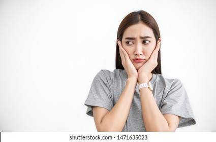 Portrait of asian female feeling painful toothache. Teeth problem woman feeling tooth pain. Closeup of beautiful sad girl suffering from strong tooth pain. Dental healthcare stressful concept.