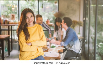 Portrait of asian female leader of working team coworking office ,Smiling of happy beautiful woman in modern office