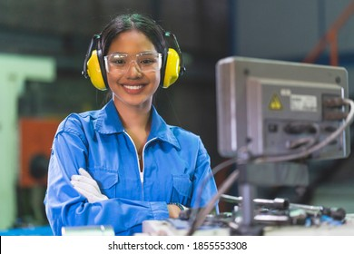 portrait asian female Professional engineering wearing uniform and safety goggles Quality control, maintenance, check in factory, warehouse Workshop for factory operators