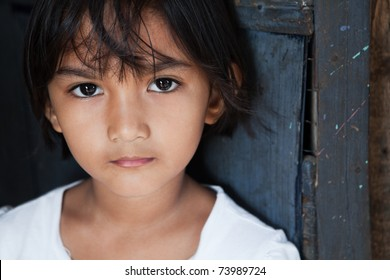 Portrait of an Asian girl against wall in natural light - Manila, Philippines