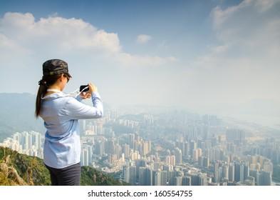 Portrait of Asian girl at Lion rock, Hong Kong