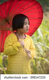 portrait of asian girl with red umbrella