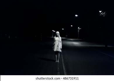 portrait of asian girl in white dress ready for halloween night,  low key picture