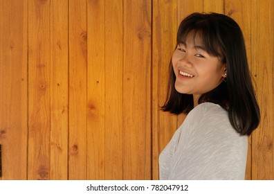 Portrait of an asian girl who have a beautiful smile and single eyelids.