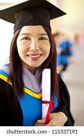 Portrait of Asian graduating student.