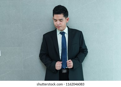 Portrait of asian handsome businessman,thailand people wearing suit,Smart guy act for take a photo